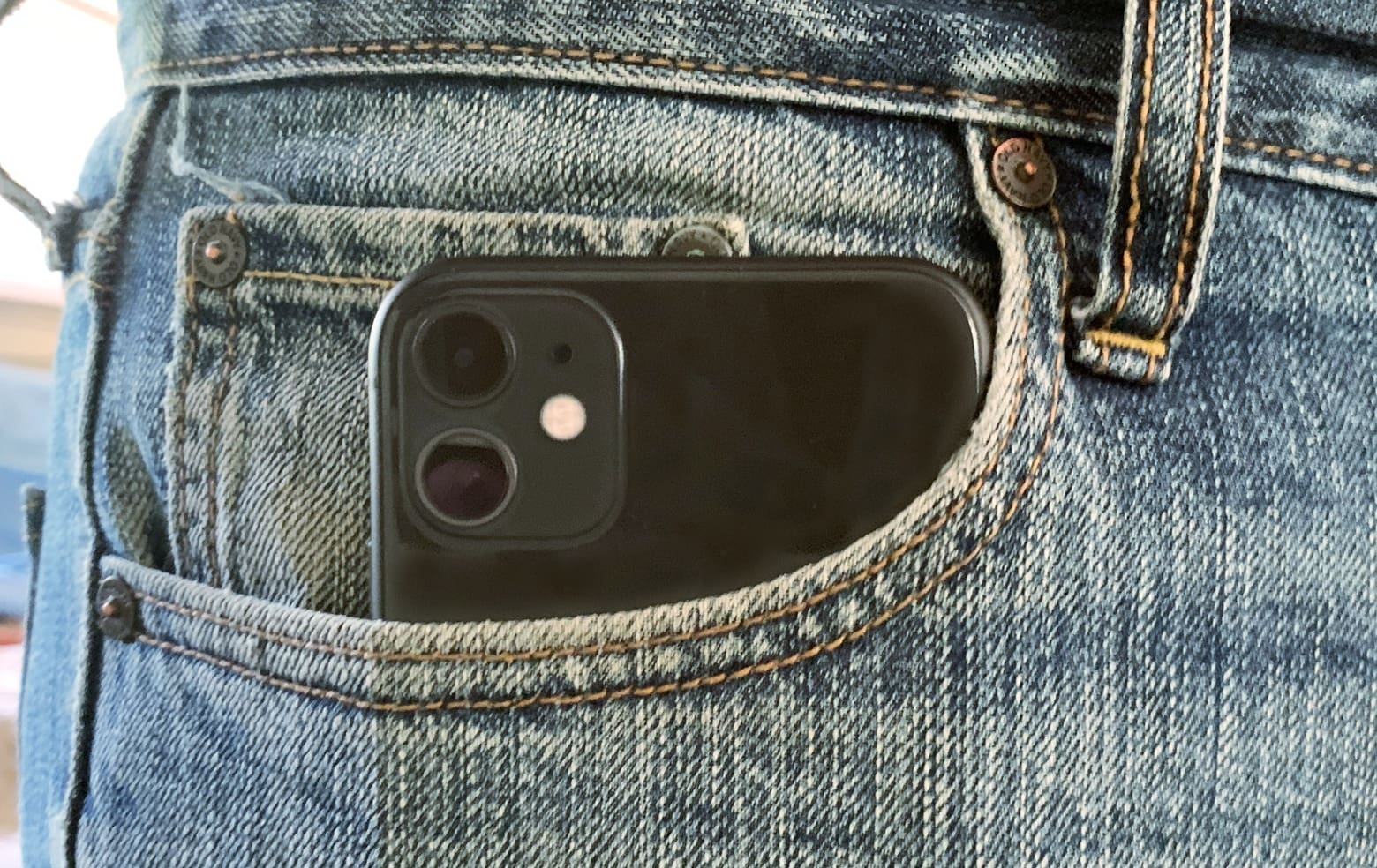 iPhone 11 in a pocket