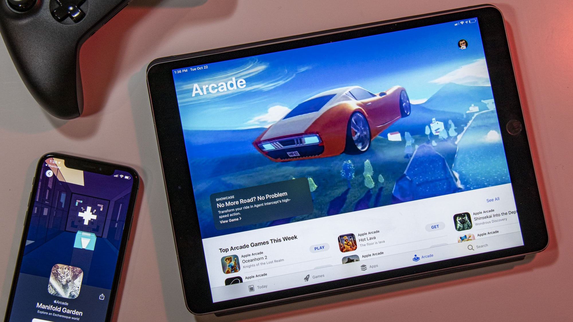 iPad browsing Apple Arcade games catalog with iPhone and Xbox Controller