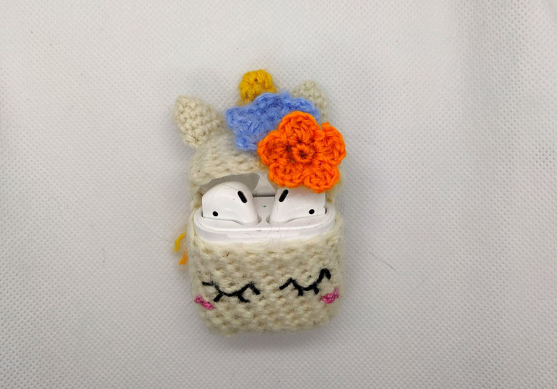 A musical unicorn adorns this crochet AirPods cover.