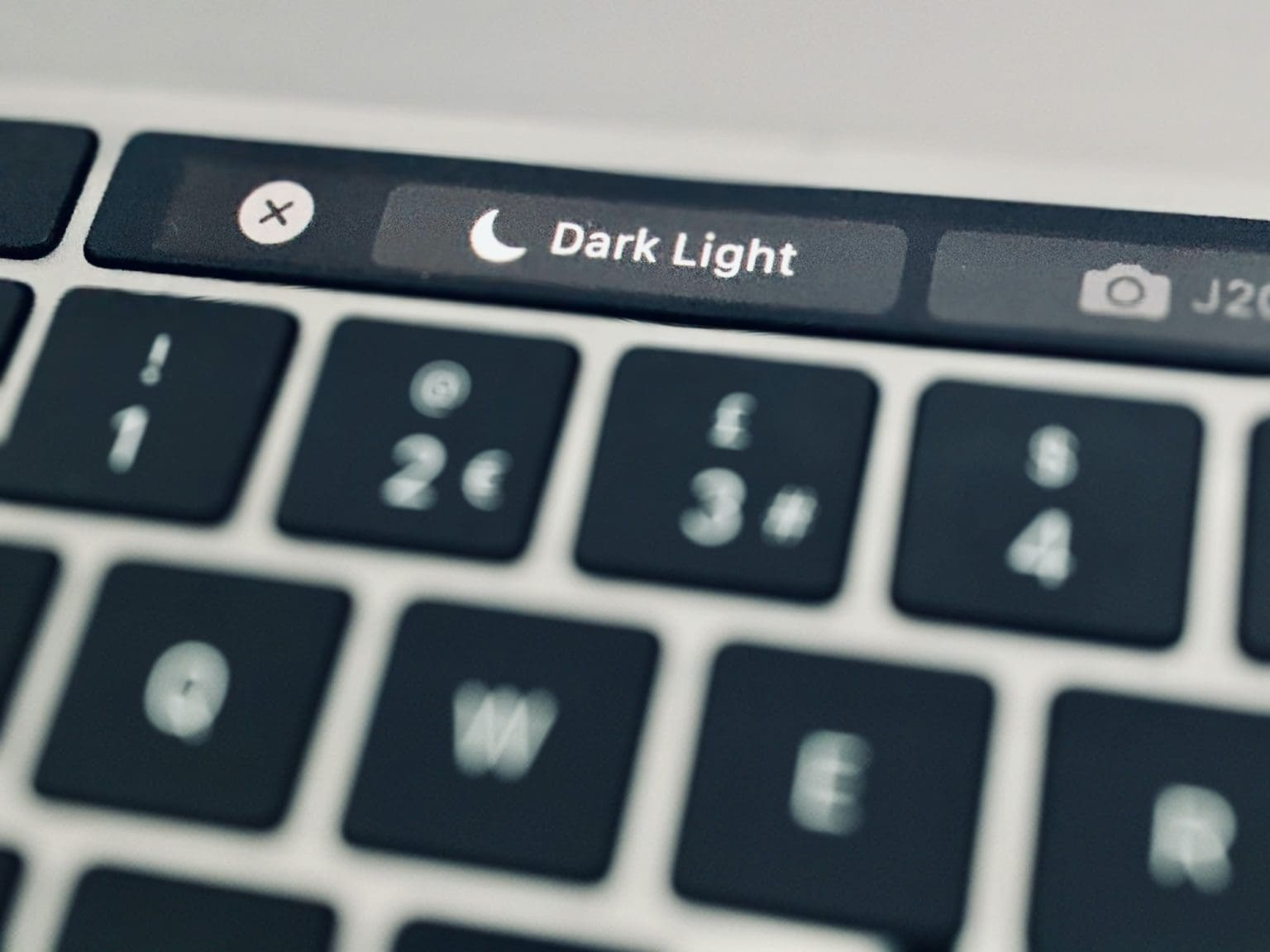 The homemade Dark Mode button lets you toggle between Dark Mode and the MacBook Pro's regular appearance, right from your Touch Bar.