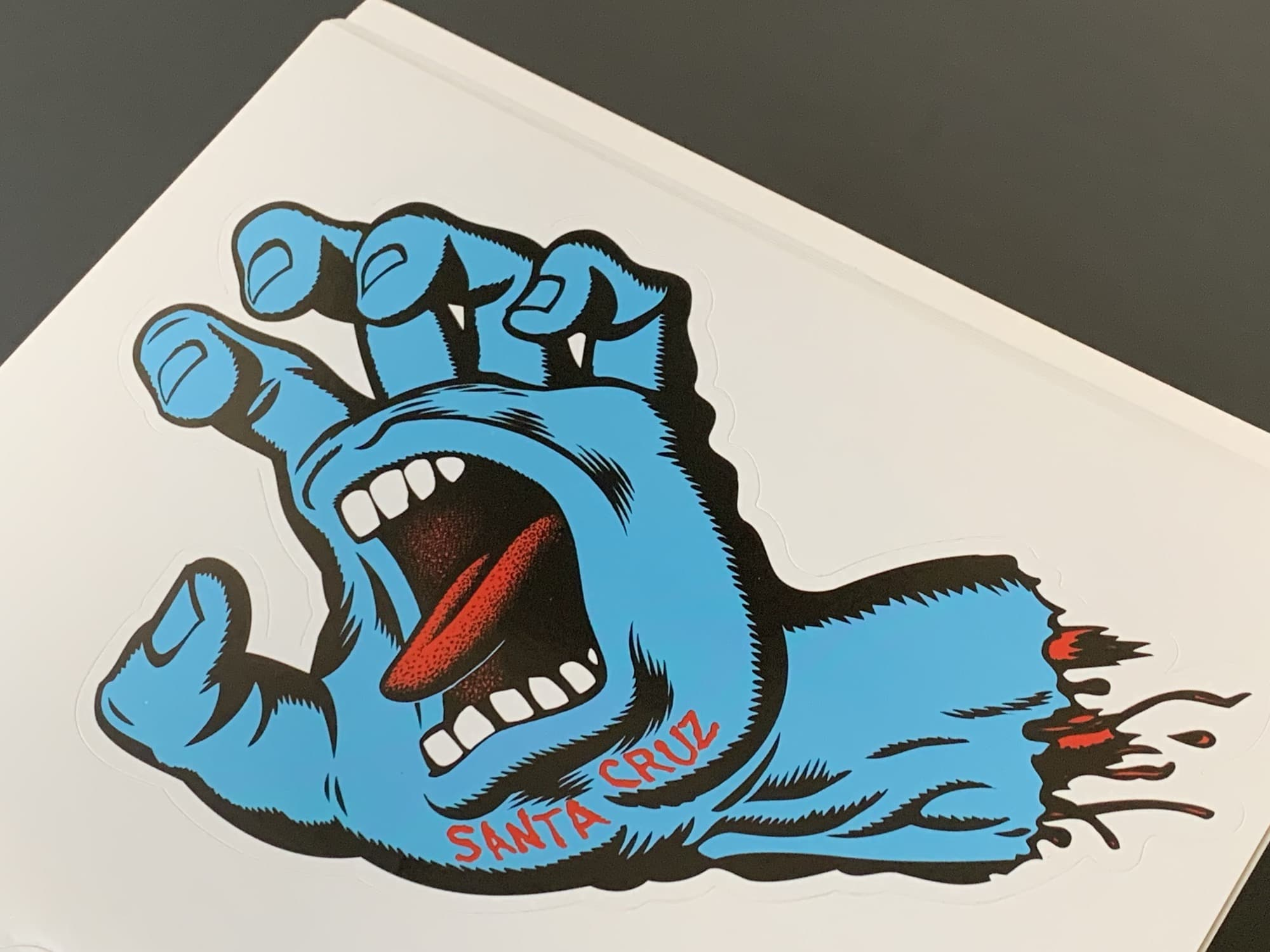 The Santa Cruz Screaming Hand is an excellent skateboard sticker for your MacBook.