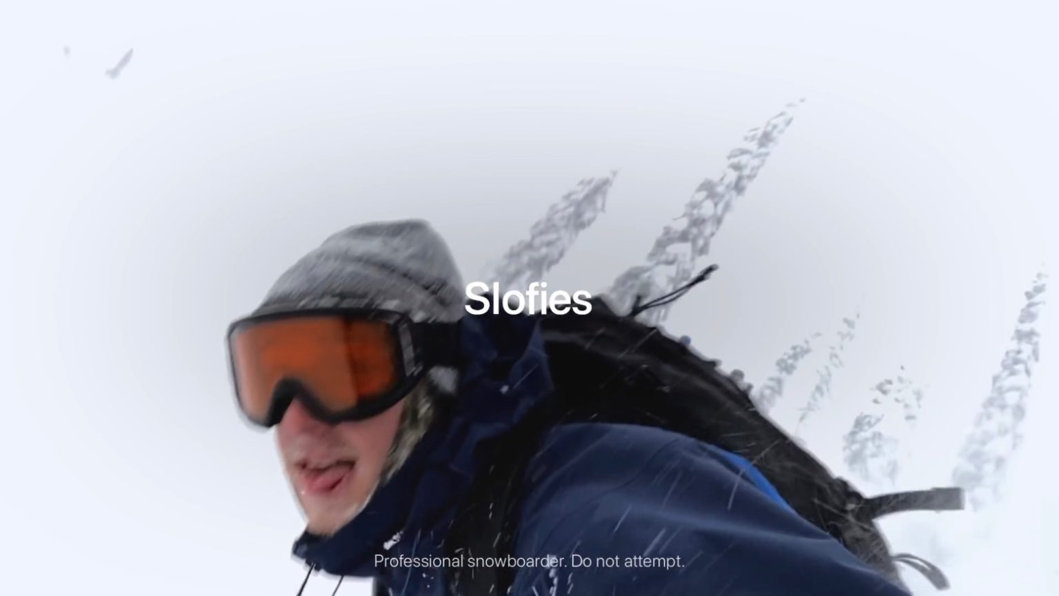 A snowboarder takes a slofie