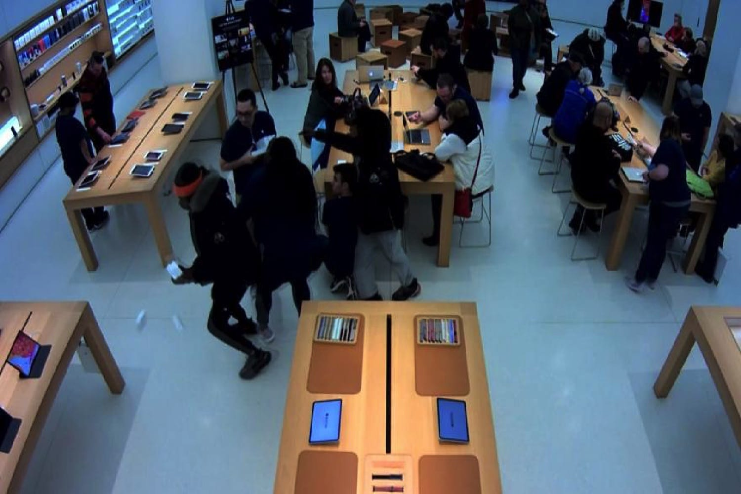 A security camera image from the Mayfair Apple Store in Wauwatosa, Wisconsin, shows alleged thieves in action.