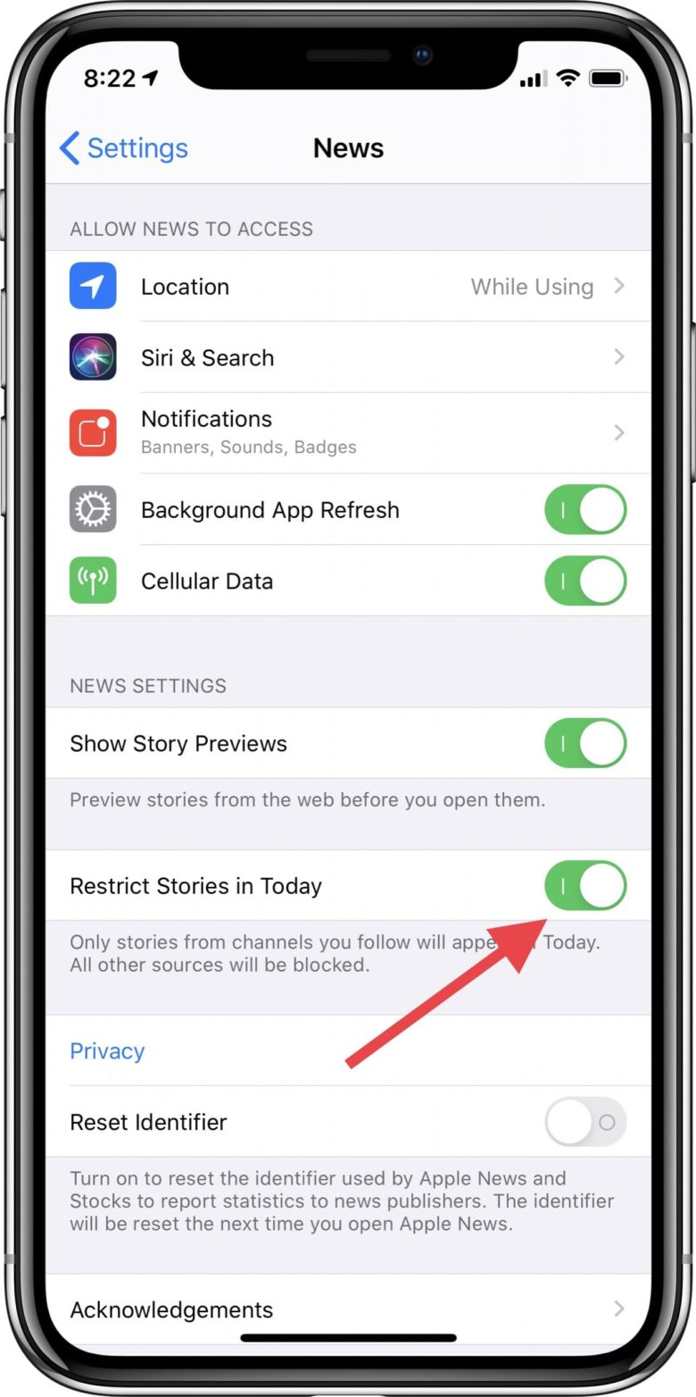 Apple News app settings with arrow pointing to restrict stories toggle