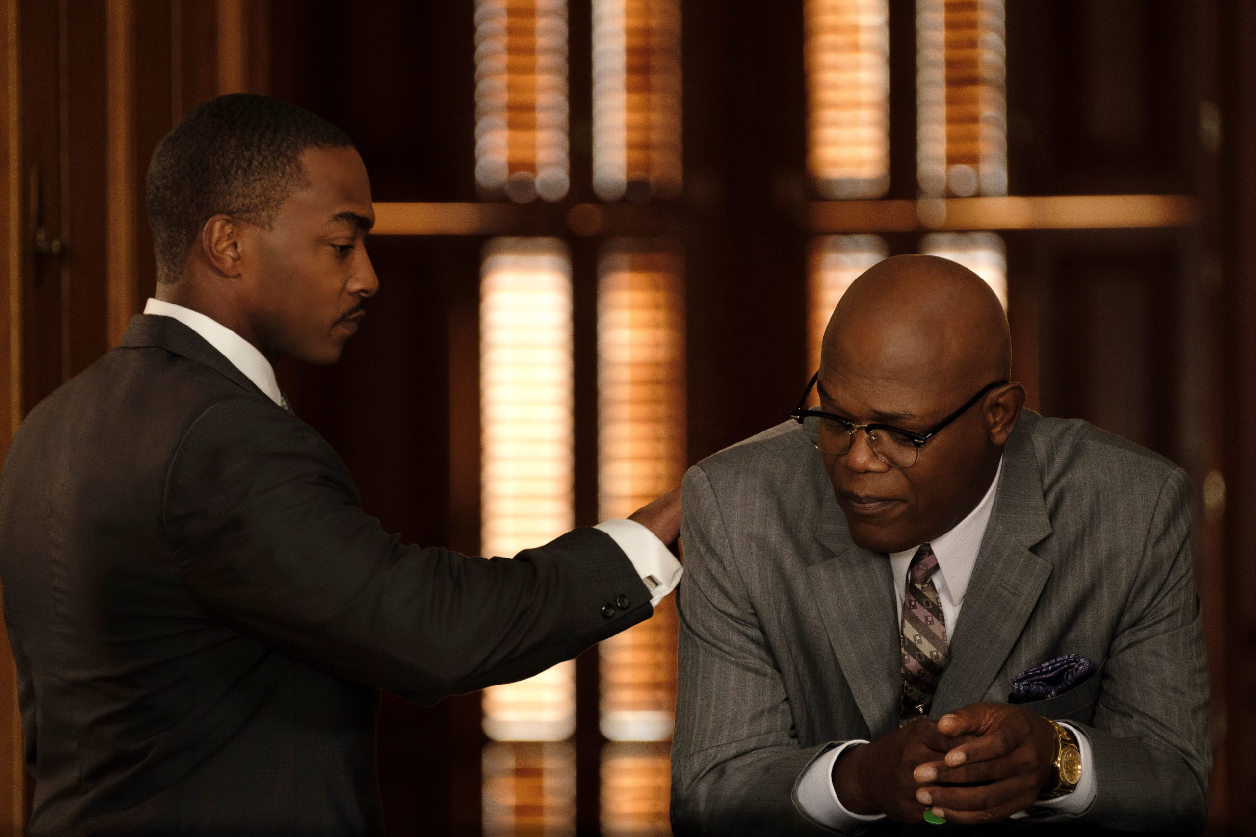 Anthony Mackie, left, and Samuel L. Jackson star in The Banker, out now on Apple TV+.