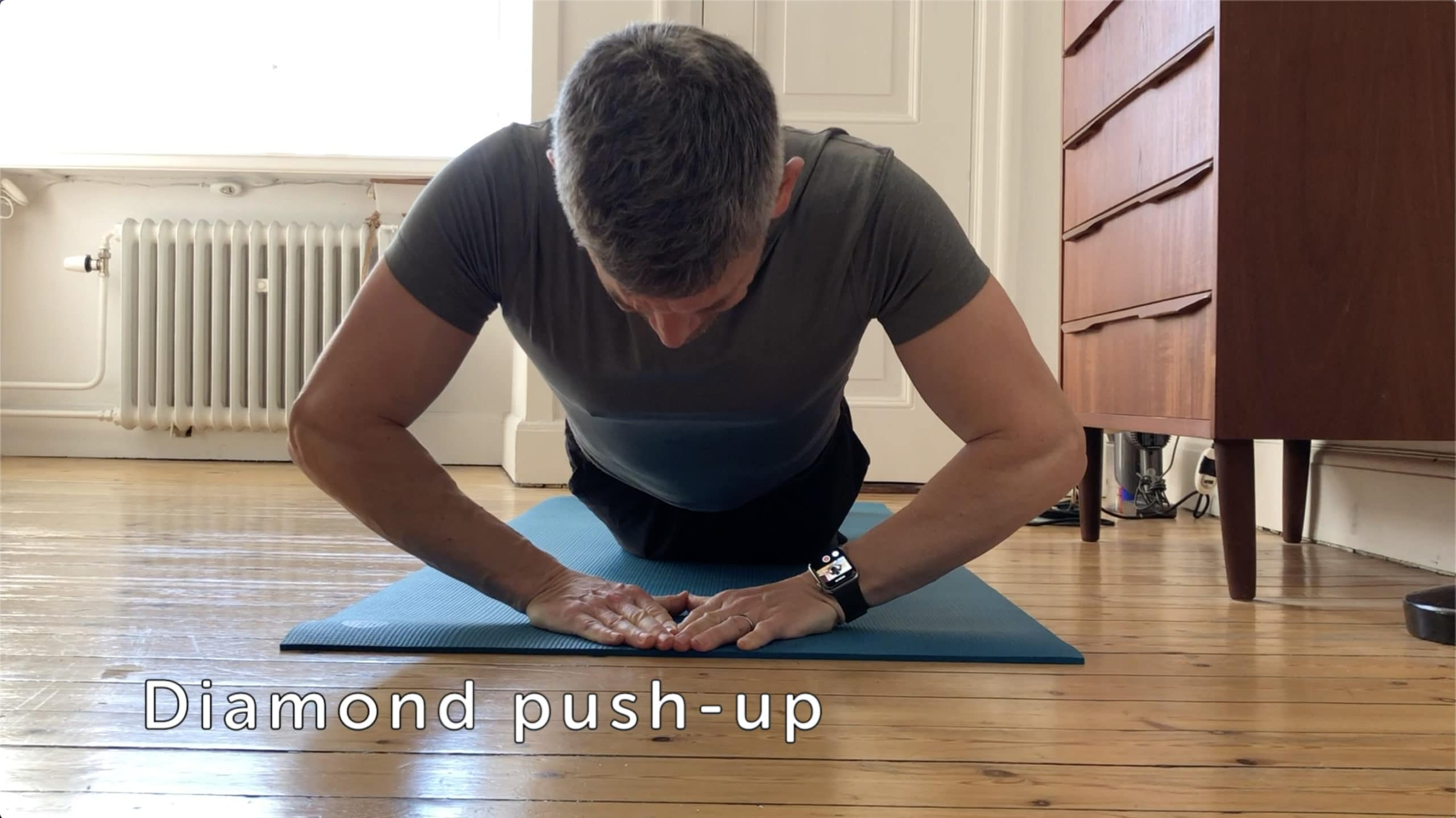 Bring your hands together for a more challenging pushup.