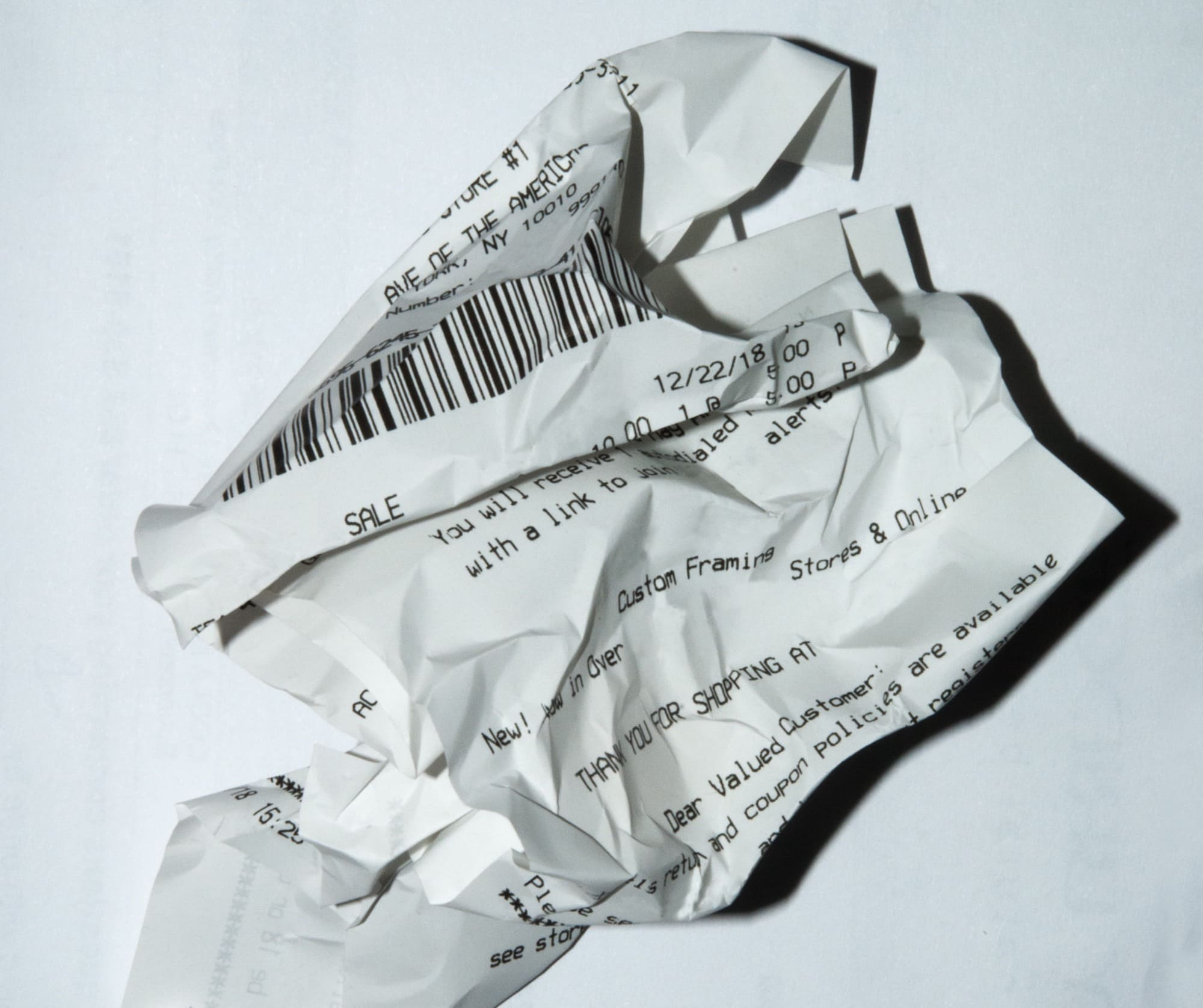 a crumpled up paper receipt
