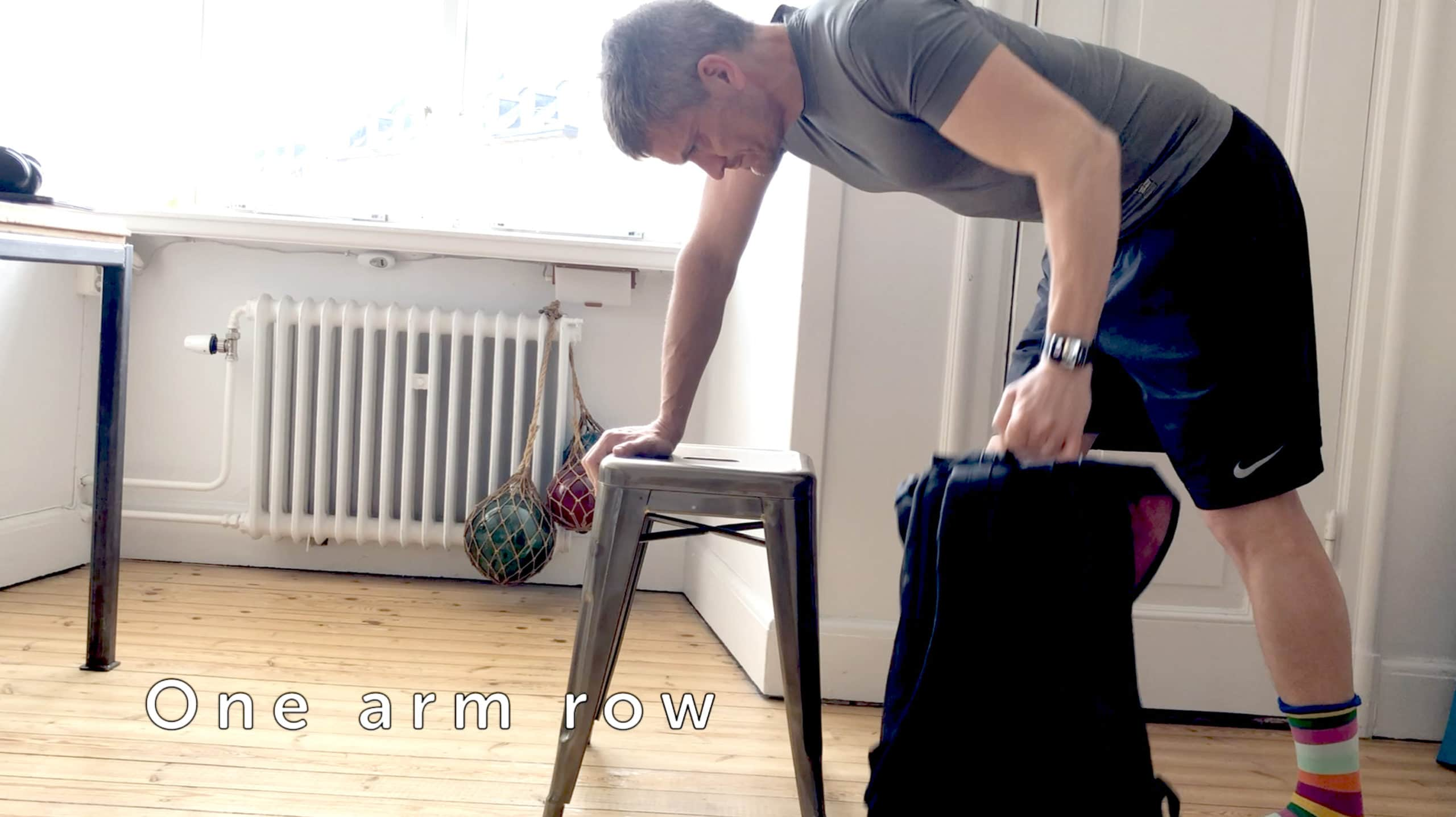 Fill a rucksack with heavy objects for an effective one-arm row.