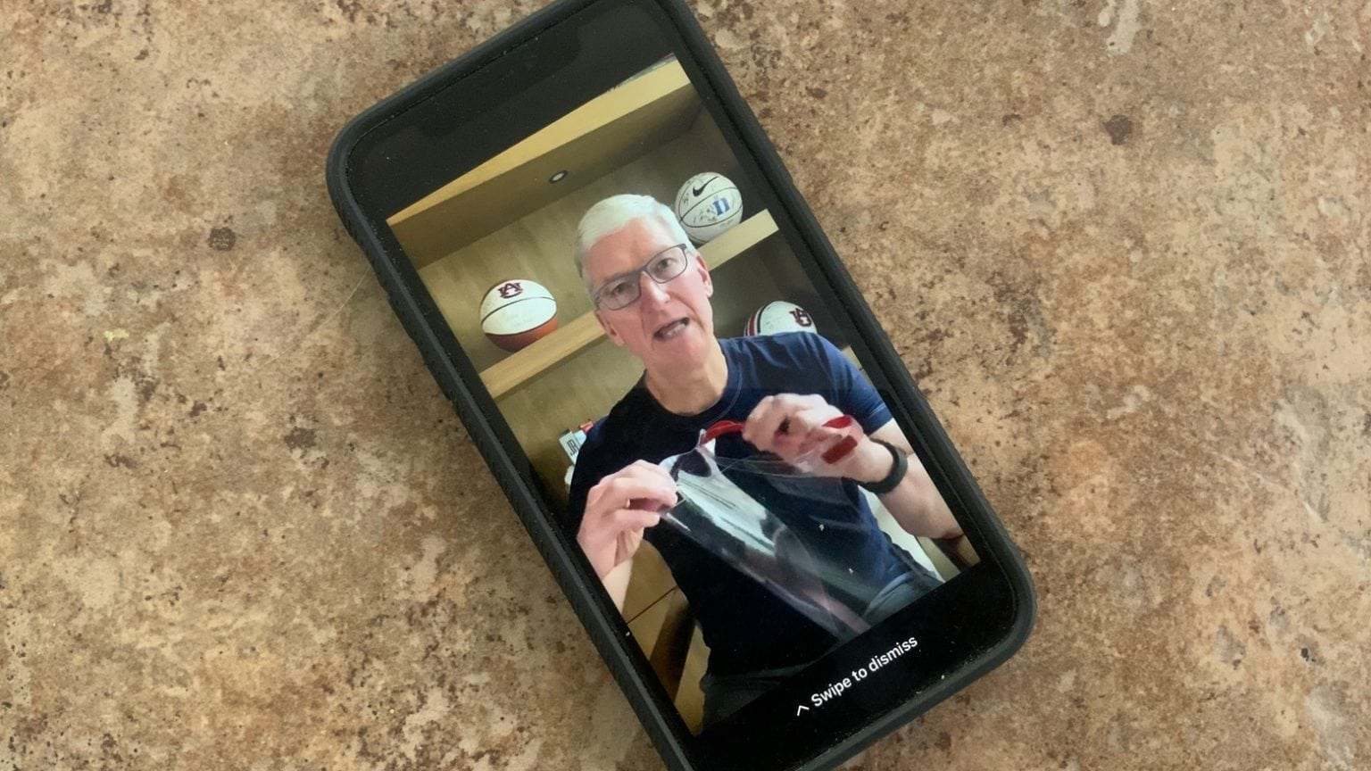 Apple CEO Tim Cook shows off a face shield Apple is making for medical workers.
