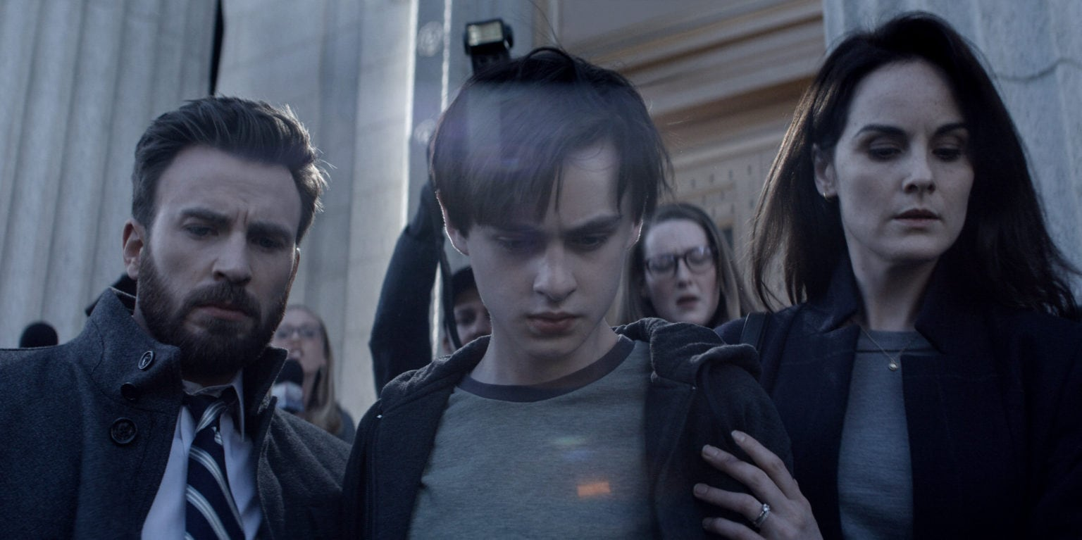 Chris Evans, Jaeden Martell and Michelle Dockery portray a family fighting suspicion in Defending Jacob.