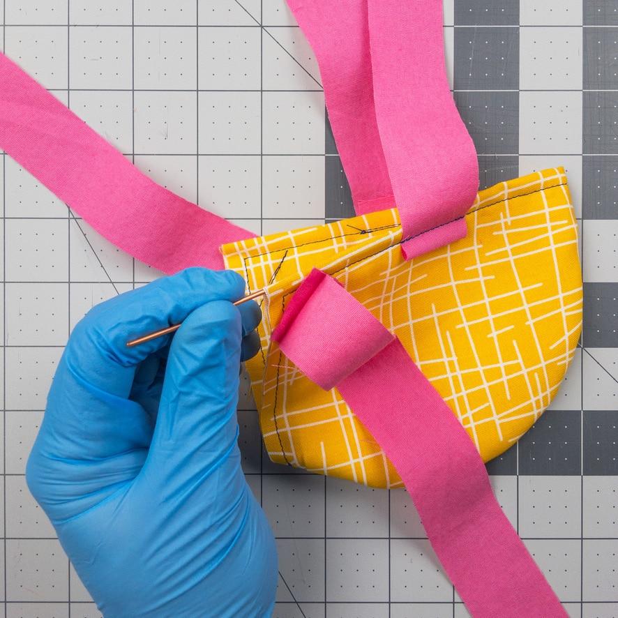 Adding wire to your homemade coronavirus mask.