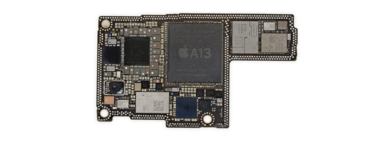 The iPhone 11 motherboard prominently includes the A13 chip.