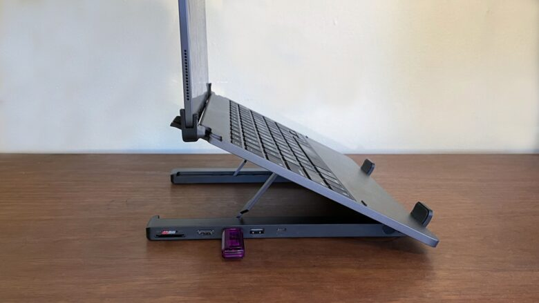 Ugreen X-Kit stand holds up your laptop keyboard, and you can plug various accessories into the built-in hub.