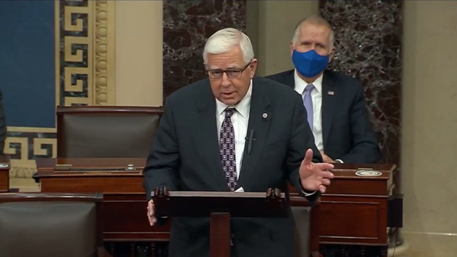 Senator Michael B Enzi says iPads and other electronic devices should be allowed on the Senate floor.