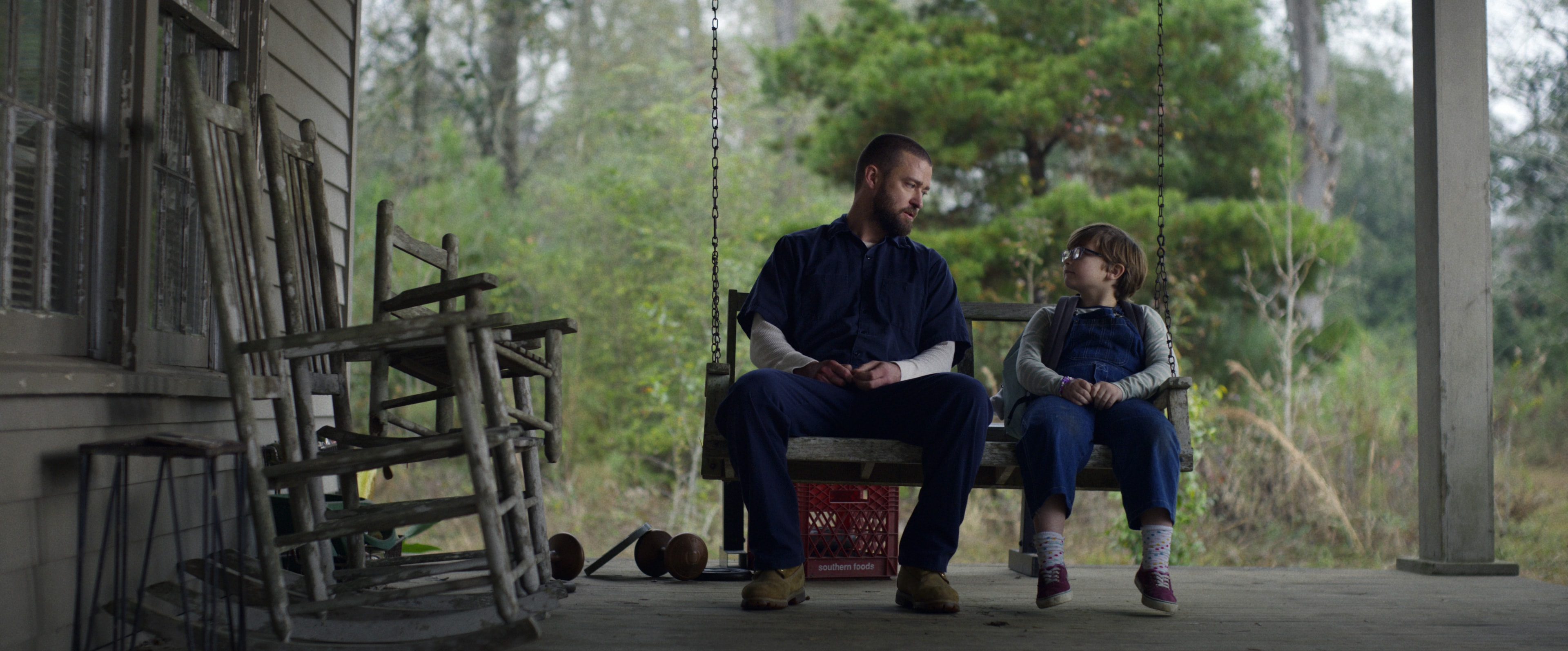 Justin Timberlake and Ryder Allen share a quiet moment in 'Palmer.'