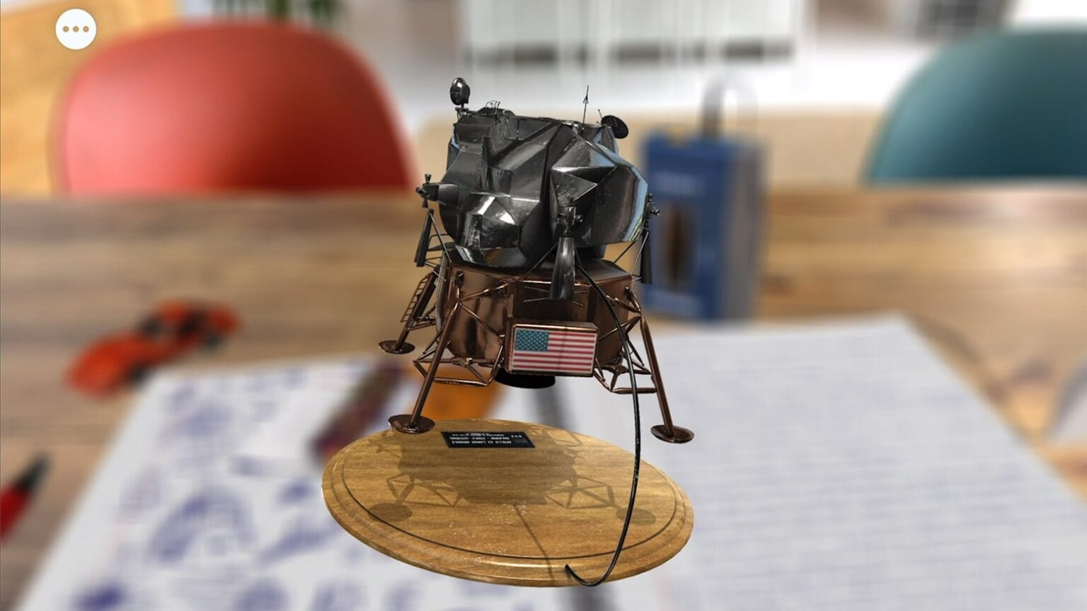 Tinker with virtual objects in a ' For All Mankind: Time Capsule' augmented-relative application.