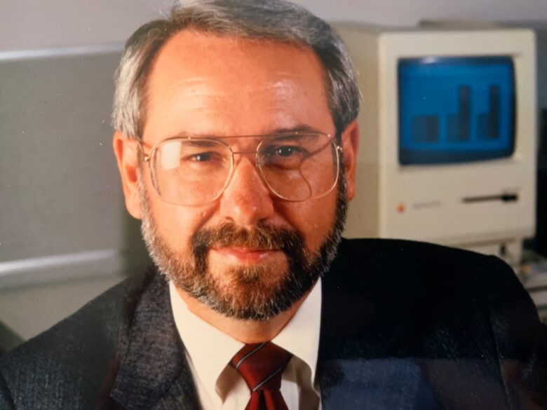 Del Yocam, pictured during his Apple days. Note the Mac behind him.