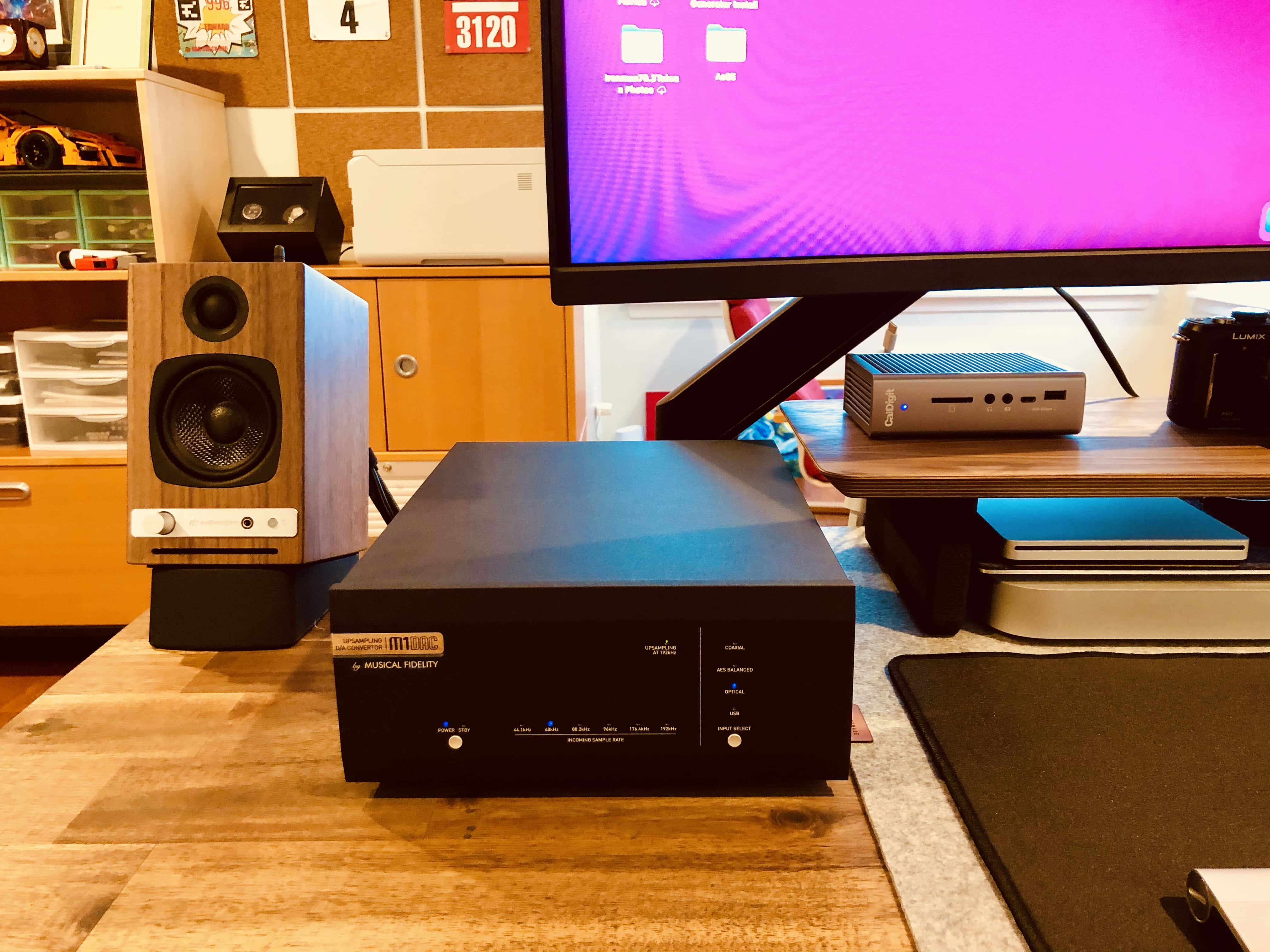 A Musical Fidelity M1DAC sits on the left side of the setup.