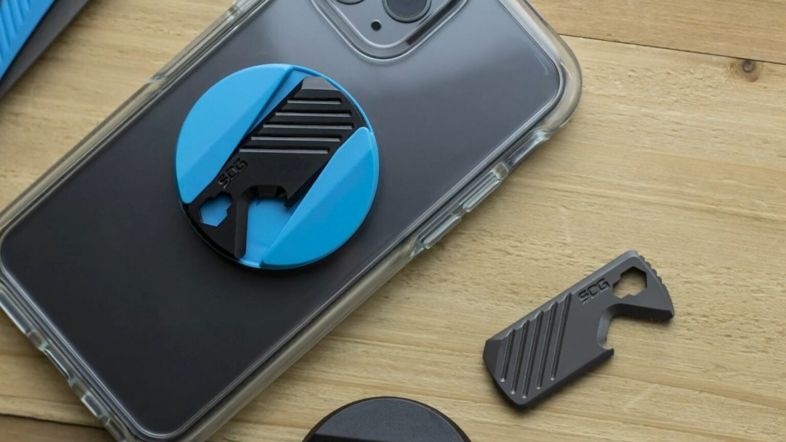 The PopGrip SOG Multi-Tool attaches a handy 5-in-1 multitool and grip to your iPhone.