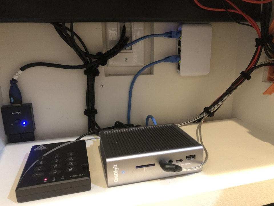 A CalDigit TS3 Dock and an encrypted 2 TB external drive are key to the setup.