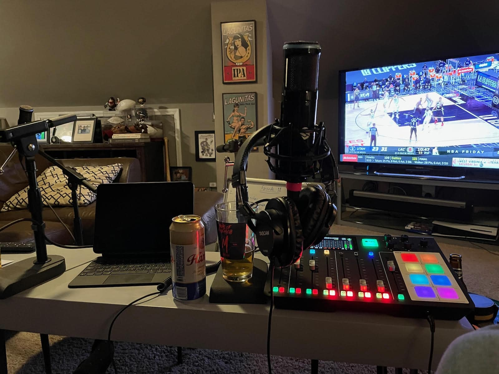 """This just screams """"podcasting,"""" right? Laptop. Console. Microphone. Headphones. Beer."""