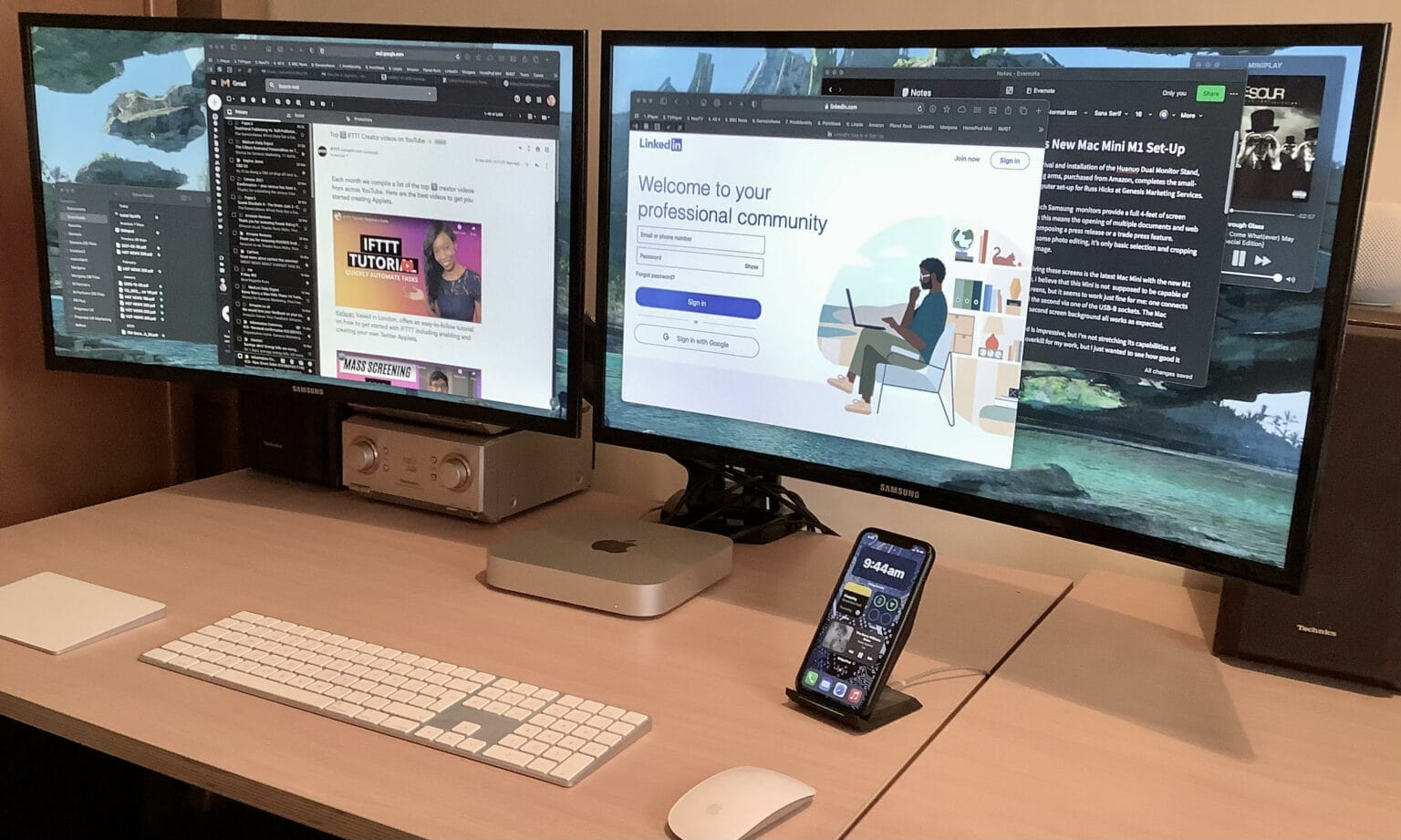 Dual curved displays and Apple keyboard, trackpad and mouse make the setup for Russ Hicks.