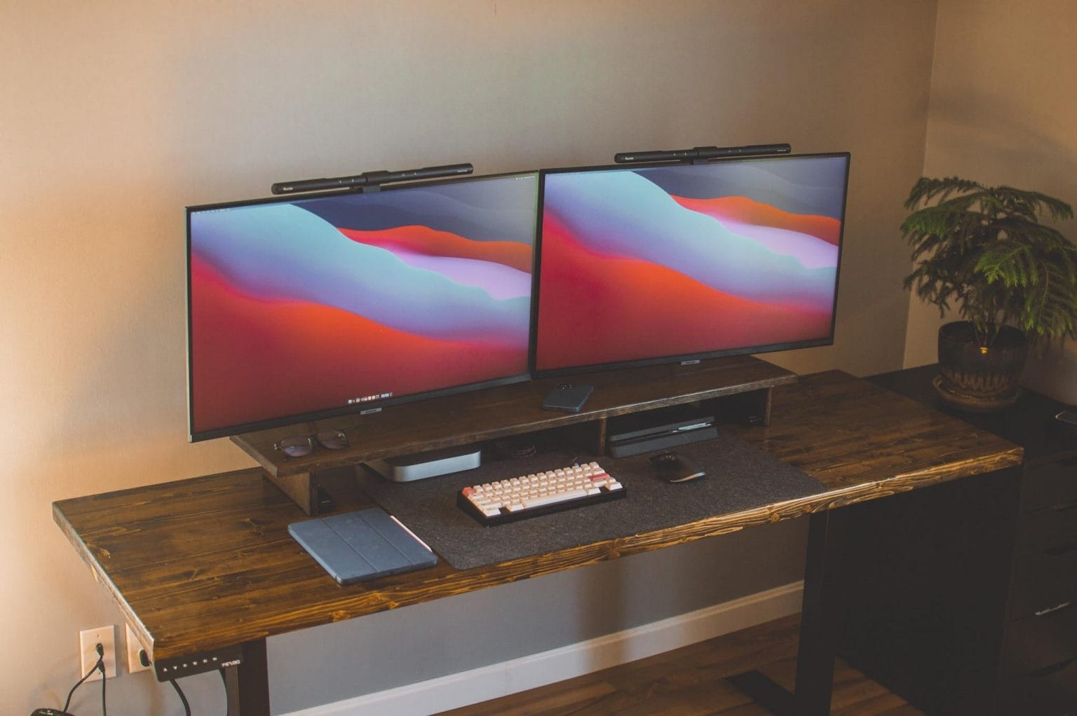 Two smart monitors with matching light bars easily run off a Mac mini M1.