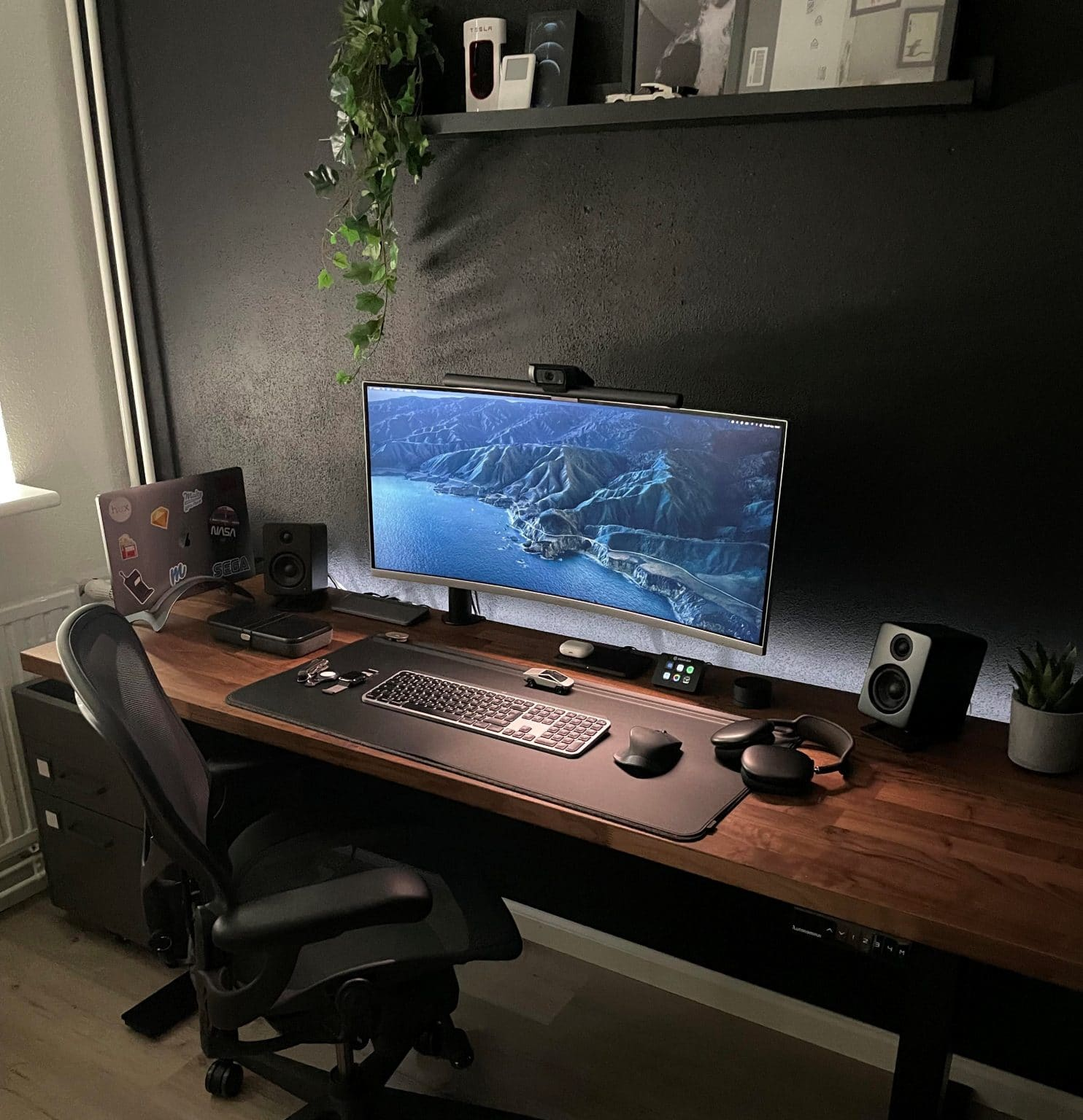 A new house calls for a first-time home office with an ultrawide monitor and plenty of toys.