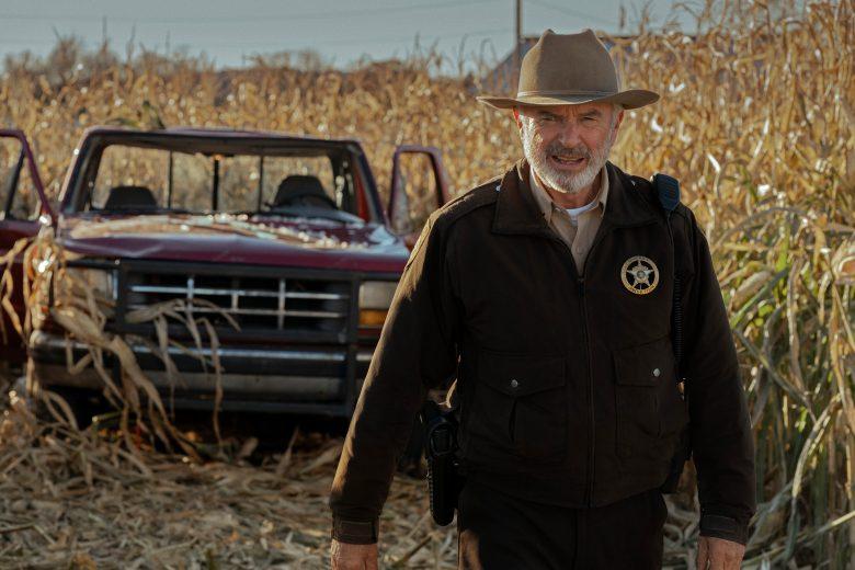 """Invasion"" on Apple TV+: Sam Neill plays the inevitable sheriff walking through the inevitable corn field."