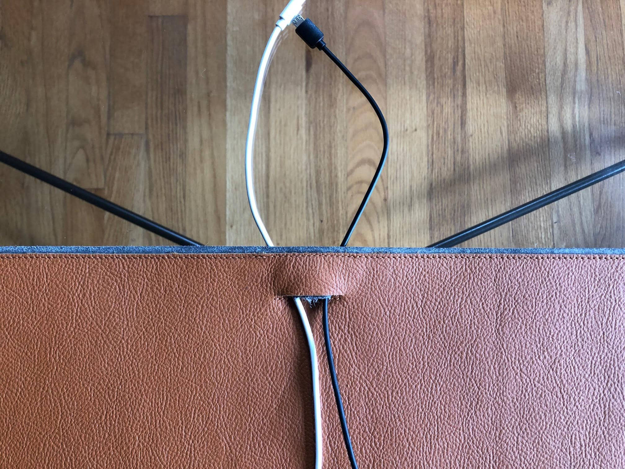 Harber London's desk mat features a cable pass-through.