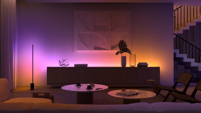 The Signe floor lamp and a light strip add ambiance.
