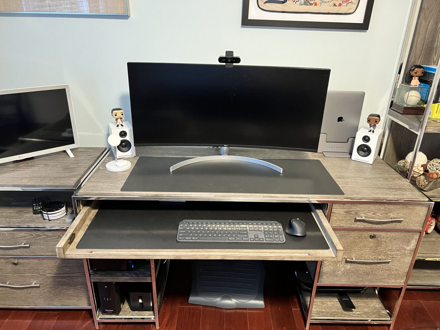 Marc Drucker's WFH setup saves some cable clutter by using the monitor as a USB hub.